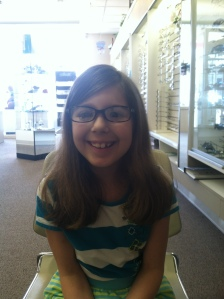 Trying on many pairs of glasses!